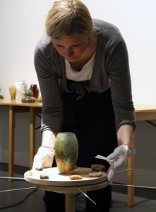 Josefin Kilner from GC handling a delicate Art Nouveau vase